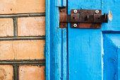 Closed Metal Latch On Blue Painted Woooden Door