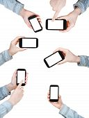 Set Of Hands Is Shirt Holding Smart Phones