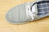 foto of canvas  - canvas Shoes on brown background, canvas shoe