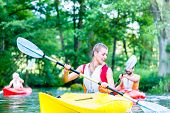 picture of canoe boat man  - Friends paddling with canoe on forest river - JPG