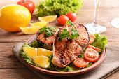foto of plate fish food  - Tasty baked fish on plate on table close - JPG
