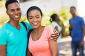 portrait of cute african college couple on campus