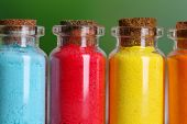picture of pigment  - Bottles with colorful dry pigments on bright background - JPG