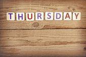 stock photo of thursday  - The word THURSDAY written in wooden letterpress type - JPG