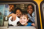 pic of pupils  - Cute pupils smiling at camera in the school bus outside the elementary school - JPG
