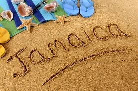 pic of starfish  - The word Jamaica written on a sandy beach with seashells beach towel starfish - JPG