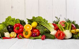 stock photo of fruits  - Fruit and vegetable borders Fruit and vegetable borders on wood table - JPG