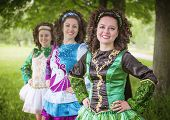picture of wig  - Three young beautiful girls in irish dance dress and wig posing outdoor - JPG