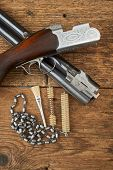 image of hunt-shotgun  - hunting gun with cleaning kit on a wooden table - JPG