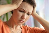 image of sick  - Portrait of a sick woman with headache at home  - JPG