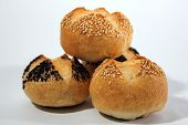 picture of sesame seed  - Kaiser roll bread with sesame and poppy seeds in a restaurant - JPG
