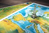 picture of atlas  - Paris destination Eiffel Tower icon on geographical map Travel concept - JPG