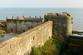 foto of fortified wall  - Curtain walls of the Portuguese fort in the Diu town in Gujarat - JPG