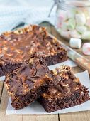 stock photo of brownie  - Homemade brownies with marshmallow on the wooden table - JPG