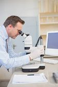 stock photo of microscope slide  - Scientist using computer and microscope in the laboratory - JPG