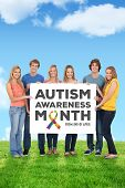 picture of aspergers  - A group of people holding blank sheet against field and sky - JPG