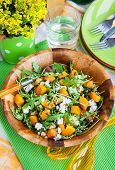 stock photo of butternut  - Delicious butternut squash arugula couscous and feta salad - JPG