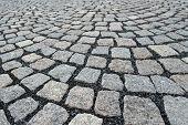 foto of granite  - a detail of old granite sidewalk on the road  - JPG