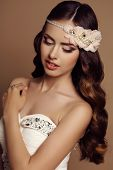 foto of headband  - fashion studio portrait of beautiful young girl with dark hair with flower - JPG