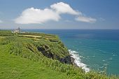 pic of lighthouse  - Lighthouse on a cliff At Ponta Da Ferraria - JPG