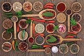 image of spoon  - Herb and spice selection in wooden bowls - JPG