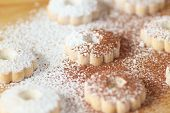 foto of sprinkling  - Closeup of italian canestrelli cookies sprinkled with powdered sugar and cocoa - JPG
