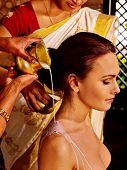 picture of panchakarma  - Woman having Pouring milk in Indian spa treatment salon - JPG