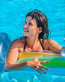 image of mattress  - Happy woman  swimming on inflatable beach mattress - JPG