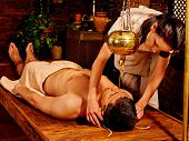 stock photo of panchakarma  - Young handsome man having spa treatment - JPG