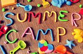 picture of molding clay  - the text summer camp made from modelling clay of different colors and some beach toys such as toy shovels and sand moulds - JPG