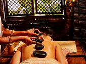 image of panchakarma  - Young woman having Ayurveda stone massage - JPG