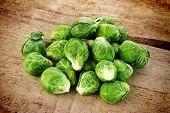 pic of brussels sprouts  - few Brussels sprouts on old wooden table - JPG