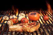 foto of rib eye steak  - BBQ Pork Rib Pepper Steak Tomato And Mushrooms On The Hot Flaming Charcoal Grill - JPG