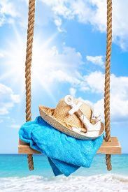 picture of anchor  - Summer swing with beach towel and anchor against an ocean blur background - JPG
