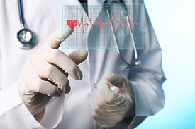 foto of beating-heart  - Doctor pressing virtual button with heart diagram - JPG