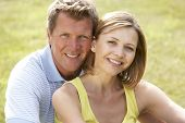 stock photo of portrait middle-aged man  - Middle aged couple having fun in countryside - JPG