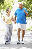 picture of senior men  - Senior Couple Jogging In Park - JPG
