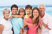 image of family fun  - Three Generation Family Relaxing On Beach Holiday - JPG