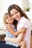 stock photo of mother-in-love  - Close Up Of Affectionate Mother And Daughter At Home - JPG