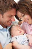 foto of cuddling  - Close Up Of Parents Cuddling Newborn Baby Boy At Home - JPG