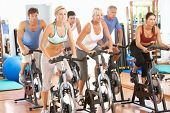 Group Of People In Cycle Class In Gym