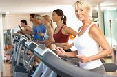 stock photo of senior class  - Senior Woman On Running Machine In Gym - JPG