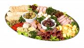 picture of cheese platter  - An antipasto catering platter of continental meats and feta cheese over a bed of mixed greens plus marinated artichoke hearts olives sun dried tomatoes and marinated eggplant - JPG