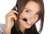 picture of telephone operator  - Beautiful Customer Representative with headset smiling during a telephone conversation - JPG