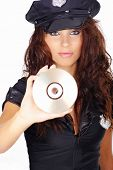 Sexy girl in police uniform holding CD disk