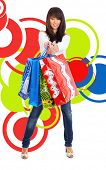 beautiful sexy shopping girl holding bag over abstract round modern design background