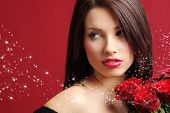 pic of beautiful woman face  - Beautiful woman with a magic rose over red background - JPG