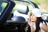portrait of beautiful summer woman in the cabrio car