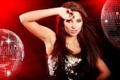pic of night-club  - sexy girl dancing over mirror ball background - JPG
