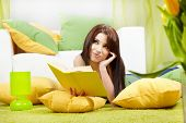 woman at home reading a book, spring concept